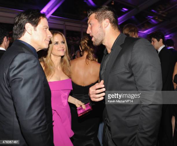 John Travolta Kelly Preston and Tim Tebow attend the 2014 Vanity Fair Oscar Party Hosted By Graydon Carter on March 2 2014 in West Hollywood...