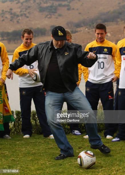 John Travolta Qantas Goodwill Ambassador kicks the ball as the Socceroos prepare ahead of the 2010 FIFA World Cup at Kloofzicht Lodge on June 11 2010...