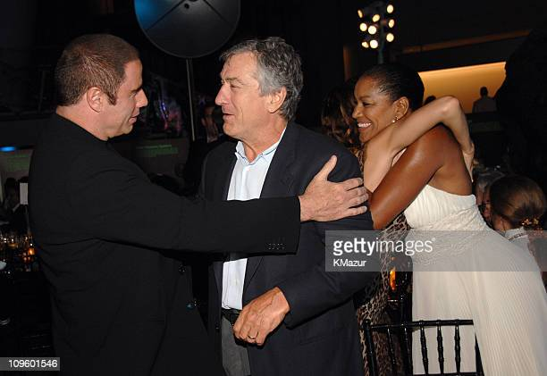 John Travolta Robert De Niro and Grace Hightower during Tony Bennett's 80th Birthday Party Inside in New York City New York United States
