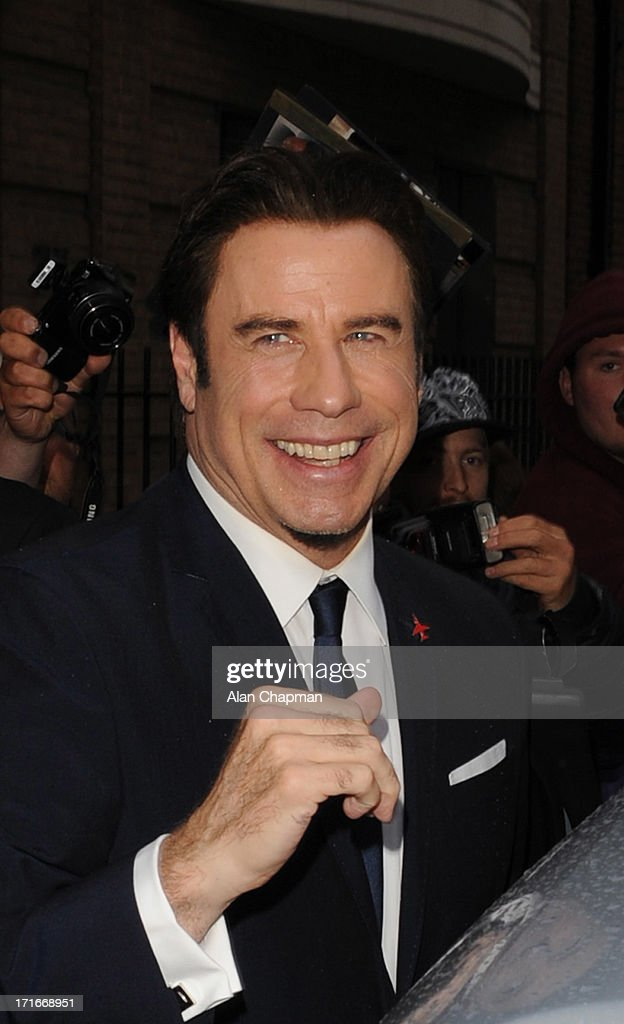 <a gi-track='captionPersonalityLinkClicked' href=/galleries/search?phrase=John+Travolta&family=editorial&specificpeople=178204 ng-click='$event.stopPropagation()'>John Travolta</a> sighting at the Breitling Flagship Store opening on June 27, 2013 in London, England.