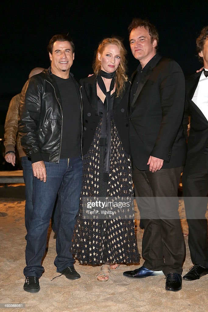 <a gi-track='captionPersonalityLinkClicked' href=/galleries/search?phrase=John+Travolta&family=editorial&specificpeople=178204 ng-click='$event.stopPropagation()'>John Travolta</a>, <a gi-track='captionPersonalityLinkClicked' href=/galleries/search?phrase=Uma+Thurman&family=editorial&specificpeople=171973 ng-click='$event.stopPropagation()'>Uma Thurman</a> and <a gi-track='captionPersonalityLinkClicked' href=/galleries/search?phrase=Quentin+Tarantino&family=editorial&specificpeople=171796 ng-click='$event.stopPropagation()'>Quentin Tarantino</a> attend a screening of Pulp Fiction at the 67th Annual Cannes Film Festival on May 23, 2014 in Cannes, France.