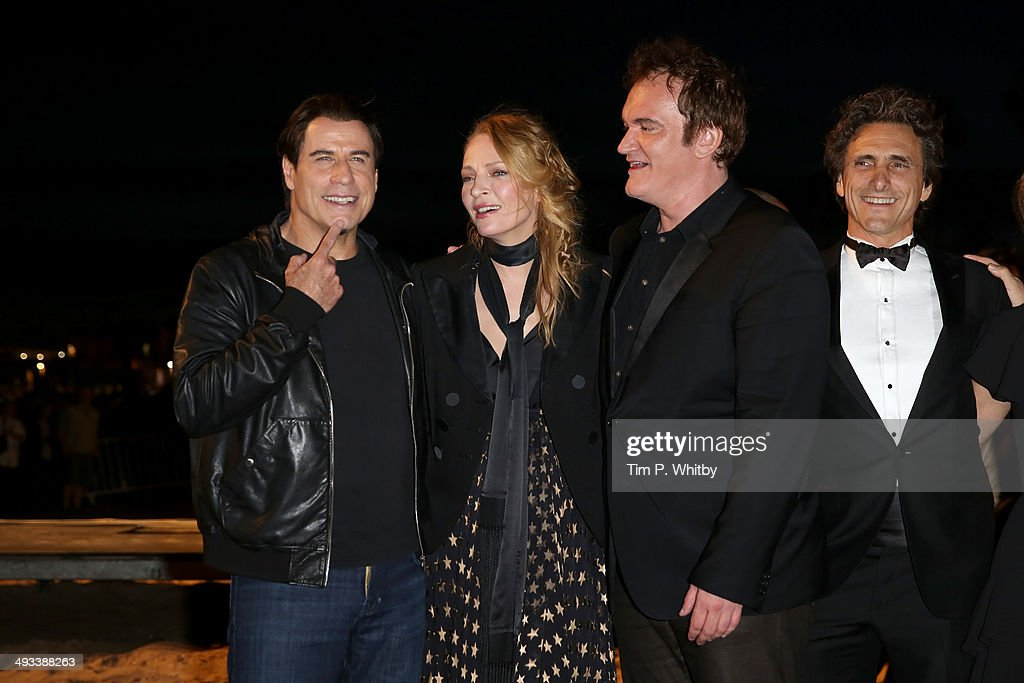 <a gi-track='captionPersonalityLinkClicked' href=/galleries/search?phrase=John+Travolta&family=editorial&specificpeople=178204 ng-click='$event.stopPropagation()'>John Travolta</a>, <a gi-track='captionPersonalityLinkClicked' href=/galleries/search?phrase=Uma+Thurman&family=editorial&specificpeople=171973 ng-click='$event.stopPropagation()'>Uma Thurman</a>, <a gi-track='captionPersonalityLinkClicked' href=/galleries/search?phrase=Quentin+Tarantino&family=editorial&specificpeople=171796 ng-click='$event.stopPropagation()'>Quentin Tarantino</a> and <a gi-track='captionPersonalityLinkClicked' href=/galleries/search?phrase=Lawrence+Bender&family=editorial&specificpeople=206529 ng-click='$event.stopPropagation()'>Lawrence Bender</a> attend a screening of Pulp Fiction at the 67th Annual Cannes Film Festival on May 23, 2014 in Cannes, France.