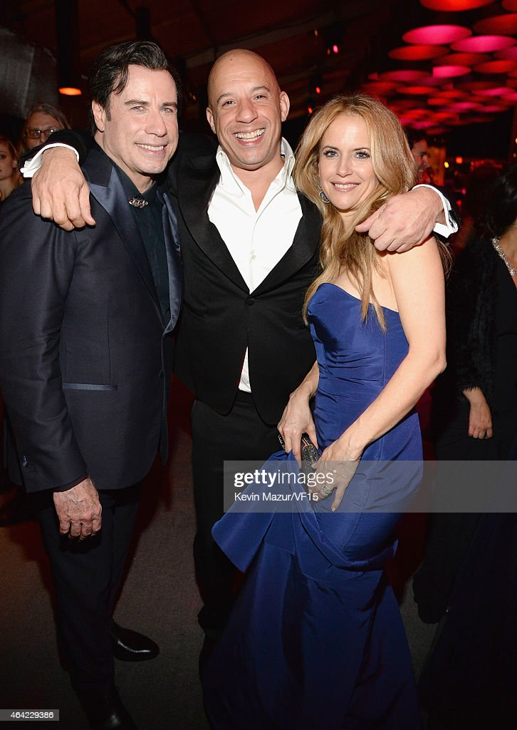 John Travolta, Vin Diesel and Kelly Preston attend the 2015 Vanity Fair Oscar Party hosted by Graydon Carter at the Wallis Annenberg Center for the Performing Arts on February 22, 2015 in Beverly Hills, California.