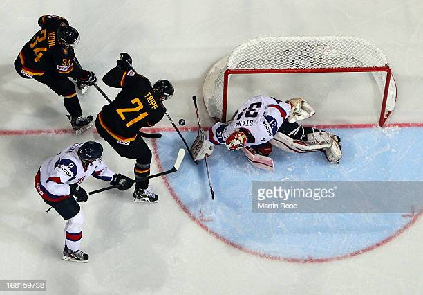 John Tripp of Germany fails to score over Rastislav Stana goaltender of Slovakia during the IIHF World Championship group H match between Germany and...