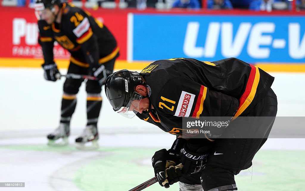 <a gi-track='captionPersonalityLinkClicked' href=/galleries/search?phrase=John+Tripp&family=editorial&specificpeople=215311 ng-click='$event.stopPropagation()'>John Tripp</a> of Germany looks dejected after the IIHF World Championship group H match between Germany and Russia at Hartwall Areena on May 5, 2013 in Helsinki, Finland.