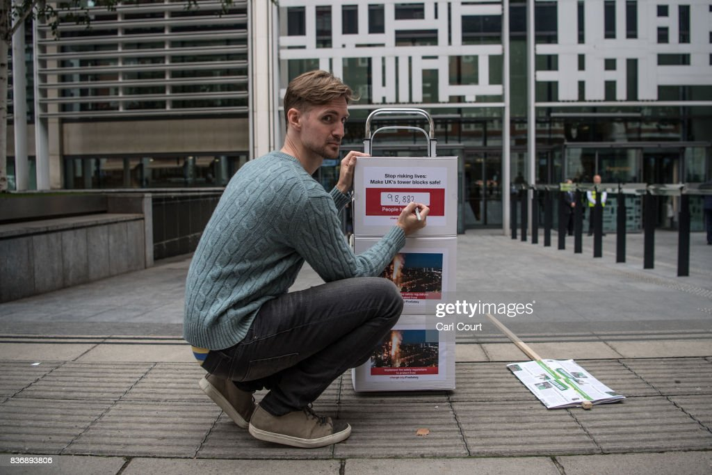 John Tyson, the founder of a petition to bring in fire safety regulations to make Britain's tower blocks safer, poses for a photograph before handing in the petition to the Department for Communities and Local Government on August 22, 2017 in London, England. The list of 99,274 signatures to the DCLG follows the critical findings of the 2013 coroner's report on the 2009 Lakanal fire, which highlighted issues that could have prevented Grenfell, the petition is asking for the immediate implementation of recommendations from that report.