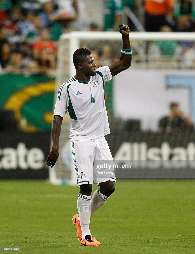 John Ugochukwu #4 of Nigeria celebrates his first half goal against Mexico at Reliant Stadium on May 31, 2013 in Houston, Texas.