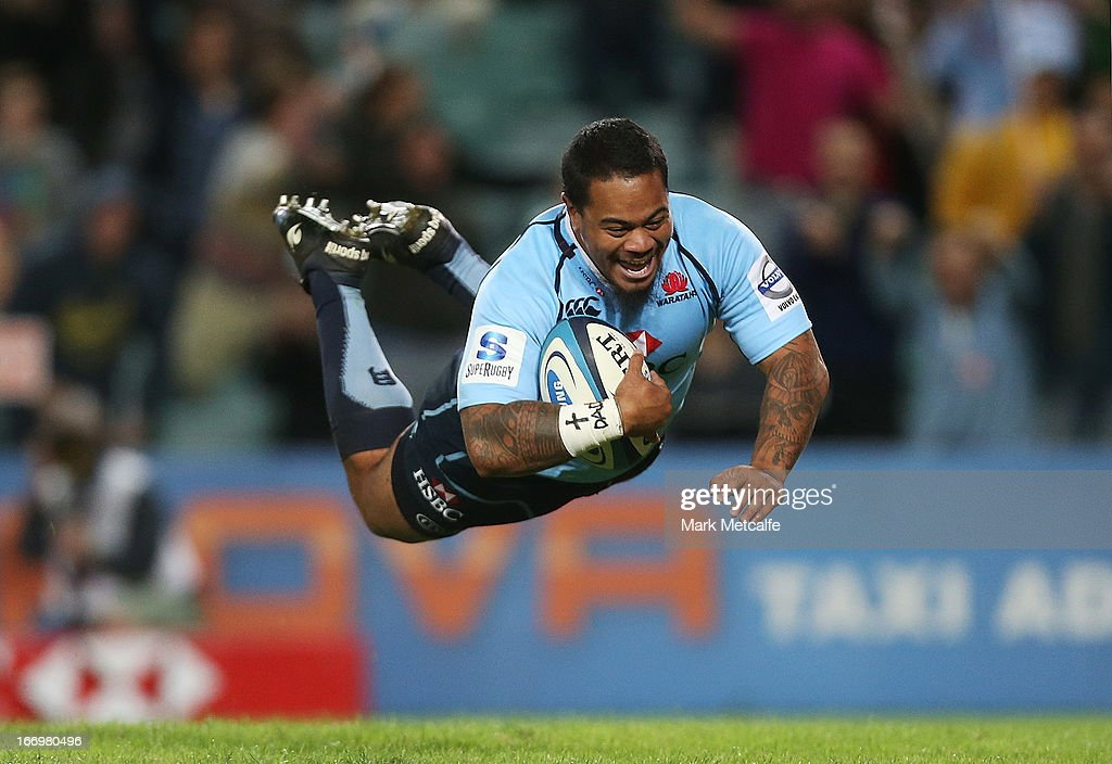 John Ulugia of the Waratahs dives over for a try during the round 10 Super Rugby match between the Waratahs and the Chiefs at Allianz Stadium on April 19, 2013 in Sydney, Australia.