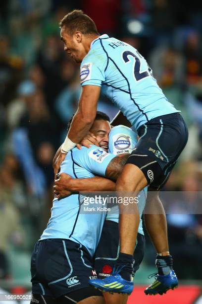 John Ulugia of the Waratahs is celebrates with Peter Betham of the Waratahs after scoring a try during the round 10 Super Rugby match between the...