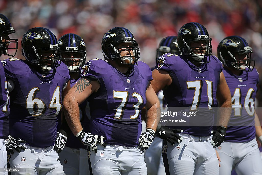 John Urschel Marshal Yanda Ricky Wagner and Morgan Cox of the Baltimore Ravens line up during an NFL football game at Raymond James Stadium on...