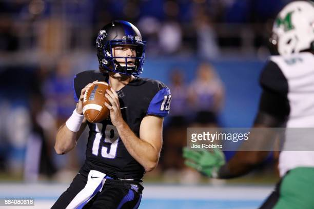 John Urzua of the Middle Tennessee Blue Raiders looks to pass in the second quarter of a game against the Marshall Thundering Herd at Floyd Stadium...