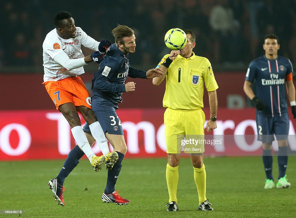 <a gi-track='captionPersonalityLinkClicked' href=/galleries/search?phrase=John+Utaka&family=editorial&specificpeople=654081 ng-click='$event.stopPropagation()'>John Utaka</a> of Montpellier and <a gi-track='captionPersonalityLinkClicked' href=/galleries/search?phrase=David+Beckham&family=editorial&specificpeople=158480 ng-click='$event.stopPropagation()'>David Beckham</a> of PSG in action during the french Ligue 1 match between Paris Saint-Germain FC and Montpellier Herault SC at the Parc des Princes stadium on March 29, 2013 in Paris, France.