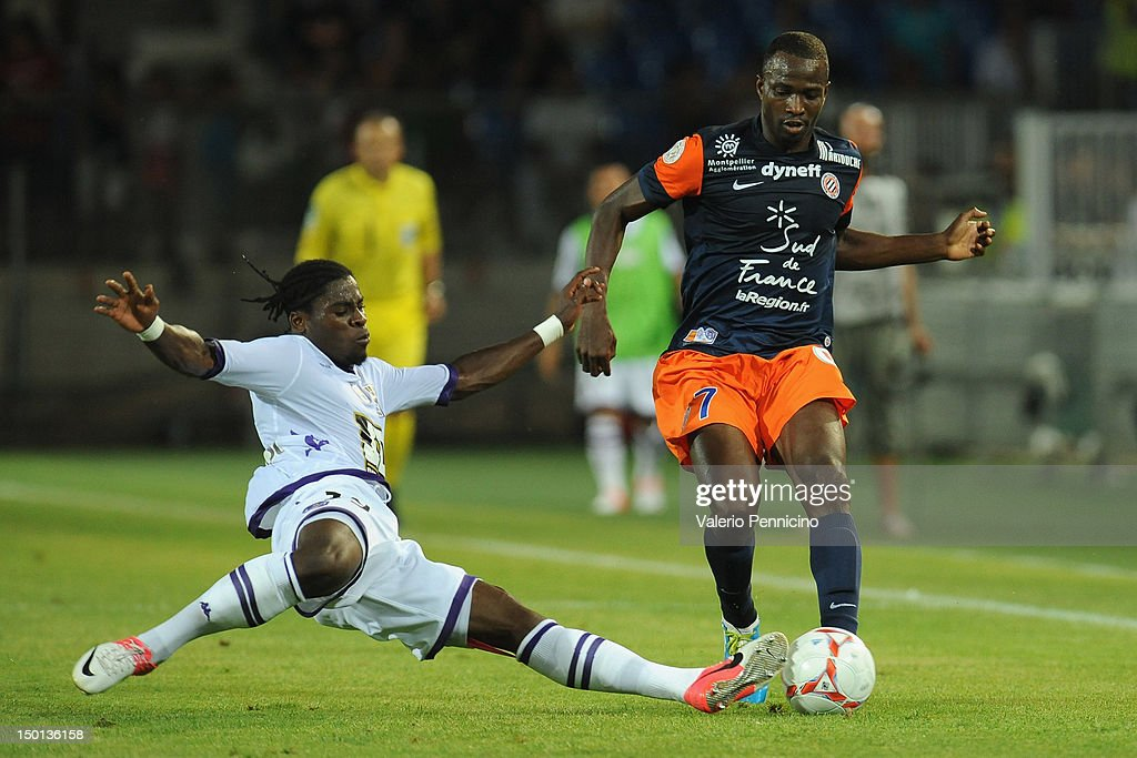 <a gi-track='captionPersonalityLinkClicked' href=/galleries/search?phrase=John+Utaka&family=editorial&specificpeople=654081 ng-click='$event.stopPropagation()'>John Utaka</a> (R) of Montpellier Herault SC is challenged by Serge Auriere of Toulouse FC during the Ligue 1 match between Montpellier Herault SC and Toulouse FC at Stade de la Mosson on August 10, 2012 in Montpellier, France.