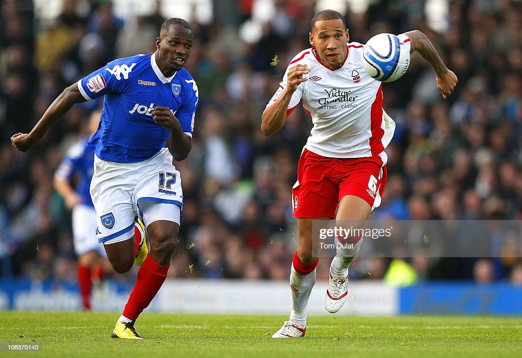 <a gi-track='captionPersonalityLinkClicked' href=/galleries/search?phrase=John+Utaka&family=editorial&specificpeople=654081 ng-click='$event.stopPropagation()'>John Utaka</a> of Portsmouth and Kelvin Wilson of Nottingham Forest battle for the ball during the npower Championship match between Portsmouth and Nottingham Forest at Fratton Park on October 30, 2010 in Portsmouth, England.