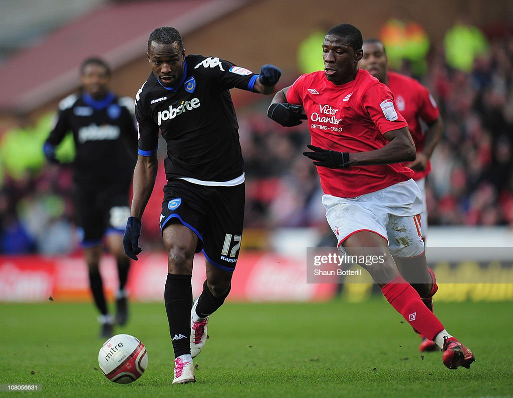 <a gi-track='captionPersonalityLinkClicked' href=/galleries/search?phrase=John+Utaka&family=editorial&specificpeople=654081 ng-click='$event.stopPropagation()'>John Utaka</a> of Portsmouth breaks away from Guy Moussi of Nottingham Forest during the npower Championship match between Nottingham Forest and Portsmouth at the City Ground on January 15, 2011 in Nottingham, England.