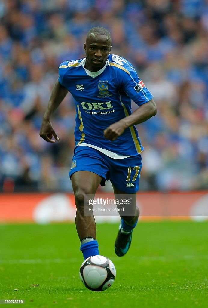 <a gi-track='captionPersonalityLinkClicked' href=/galleries/search?phrase=John+Utaka&family=editorial&specificpeople=654081 ng-click='$event.stopPropagation()'>John Utaka</a> of Portsmouth in action during the Cardiff City v Portsmouth FA Cup Final Match at Wembley Stadium , London , UK.