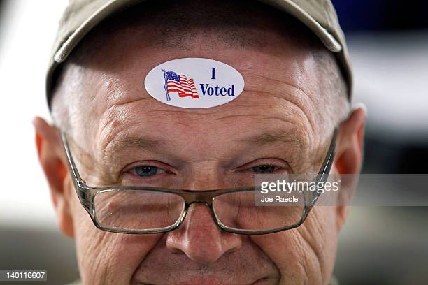 John Vandermark wears his ' I Voted' sticker after voting on primary day as Michigan heads to the polls at Royal Oak Farmers Market on February 28...