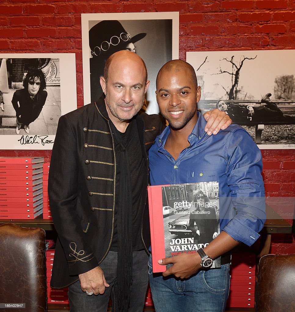 John Varvatos and Beau Beasley attends the Rock in Fashion Book Launch at John Varvatos South Beach Miami on October 19, 2013 in Miami, Florida.