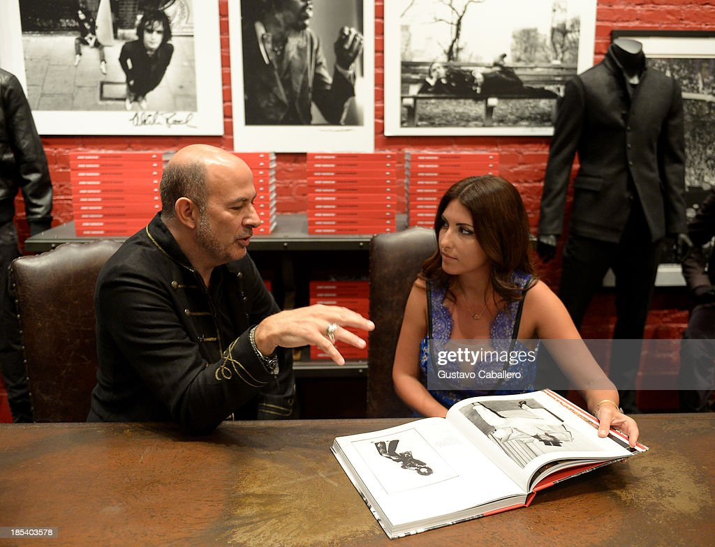John Varvatos and Biana Demarco attends the Rock in Fashion Book Launch at John Varvatos South Beach Miami on October 19, 2013 in Miami, Florida.