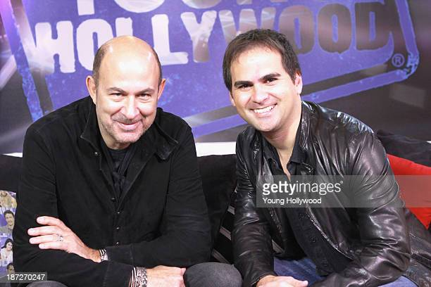 John Varvatos and host RJ Williams at the Young Hollywood Studio on November 7 2013 in Los Angeles California