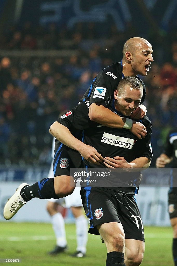 John Verhoek of Frankfurt celebrates his team's first goal with Zafer Yelen of Frankfurt (Top) during the Second Bundesliga match between FSV Frankfurt and VfR Aalen at Frankfurter Volksbank Stadium on March 8, 2013 in Frankfurt am Main, Germany.