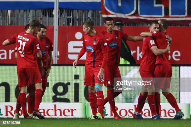 John Verhoek of Heidenheim celebrates his team's second goal with team mates during the Second Bundesliga match between SV Sandhausen and 1 FC...