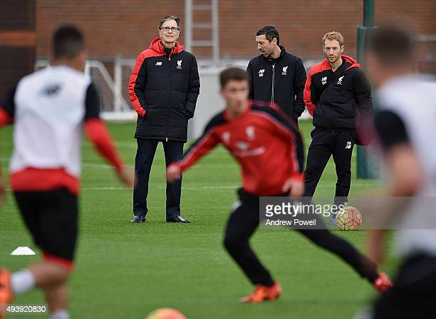 John W Henry and Tom Werner part owners of Liverpool FC watch a training session at Melwood Training Ground on October 23 2015 in Liverpool England