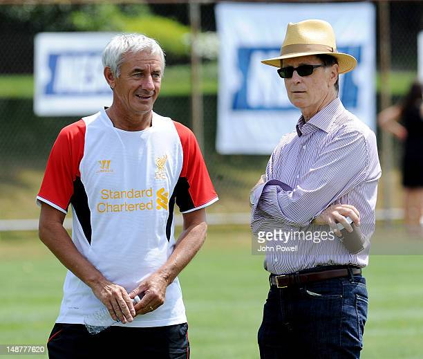John W Henry principal owner of Liverpool talks with former player Ian Rush during a training session at Harvard University on July 19 2012 in Boston...