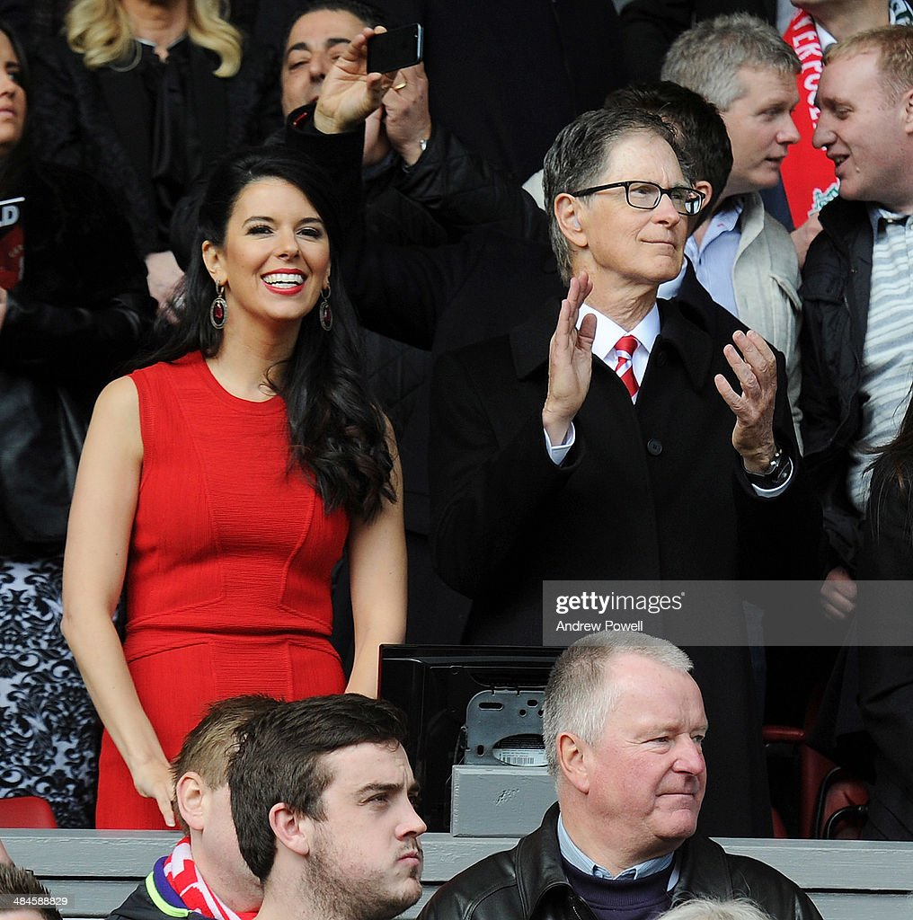 John W Henry, principle owner of Liverpool and his wife Linda Pizzuti react during the Barclays Premier Leuage match between Liverpool and Manchester City at Anfield on April 13, 2014 in Liverpool, England.