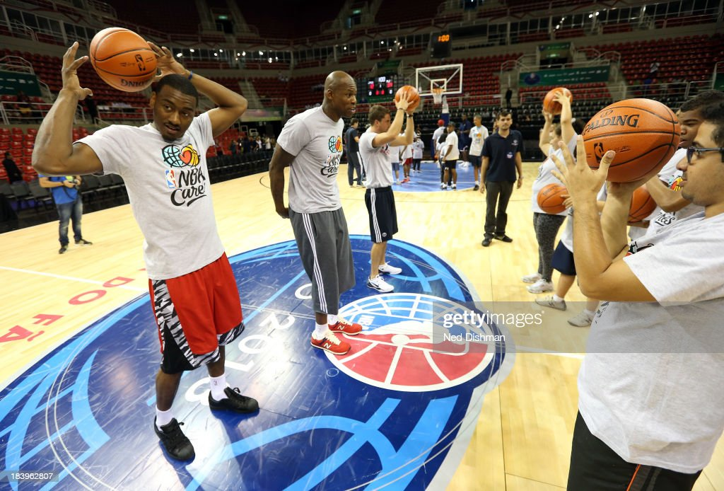 John Wall #2 and Al Harrington of the Washington Wizards do drills during a Special Olympics Basketball Clinic as part of 2013 Global Games on October 10, 2013 at HSBC Arena in Rio de Janiero, Brazil.