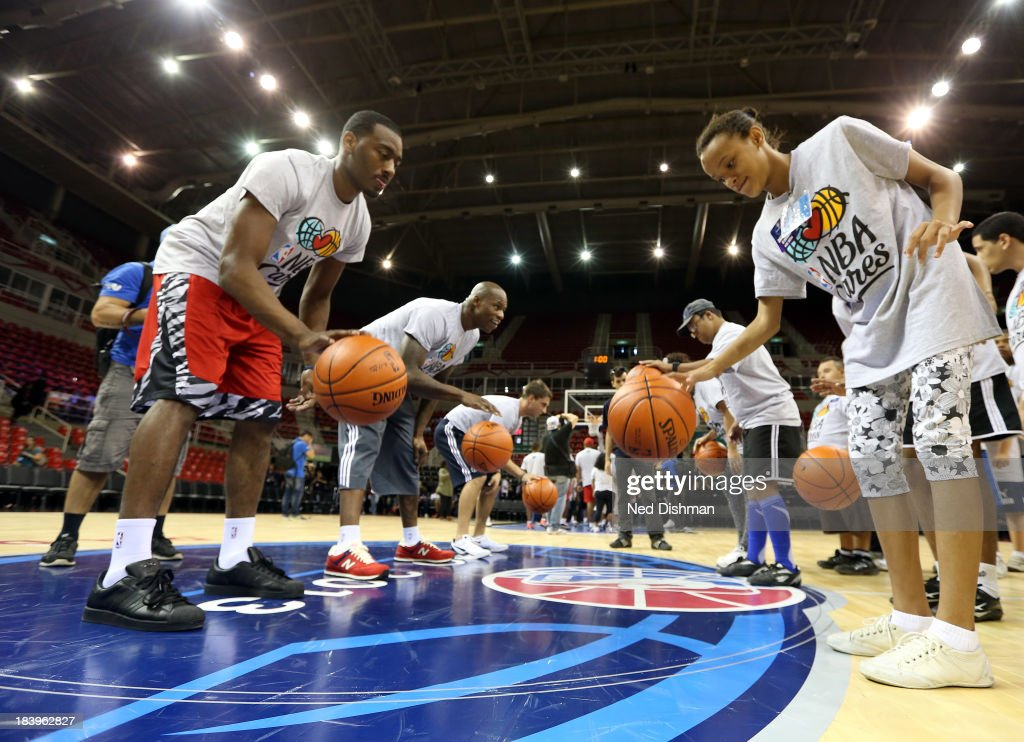 John Wall #2 and Al Harrington of the Washington Wizards dribble during a Special Olympics Basketball Clinic as part of 2013 Global Games on October 10, 2013 at HSBC Arena in Rio de Janiero, Brazil.