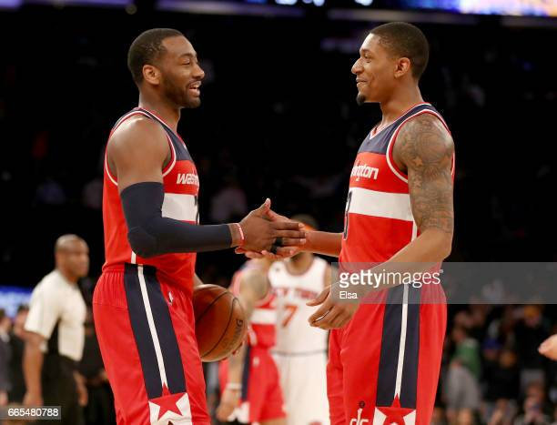 John Wall and Bradley Beal of the Washington Wizards celebrate the 106103 win over the New York Knicks at Madison Square Garden on April 6 2017 in...