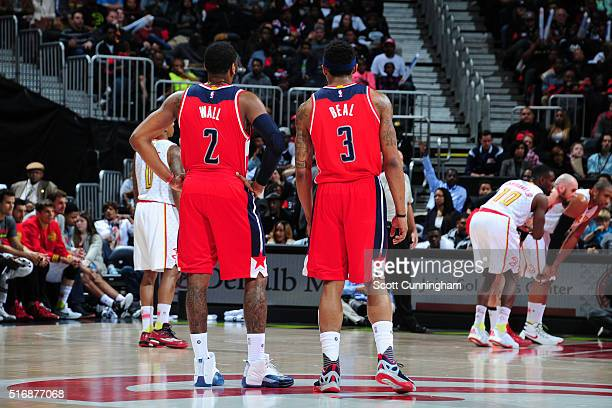 John Wall and Bradley Beal of the Washington Wizards during the game against the Atlanta Hawks on March 21 2016 at Philips Arena in Atlanta Georgia...