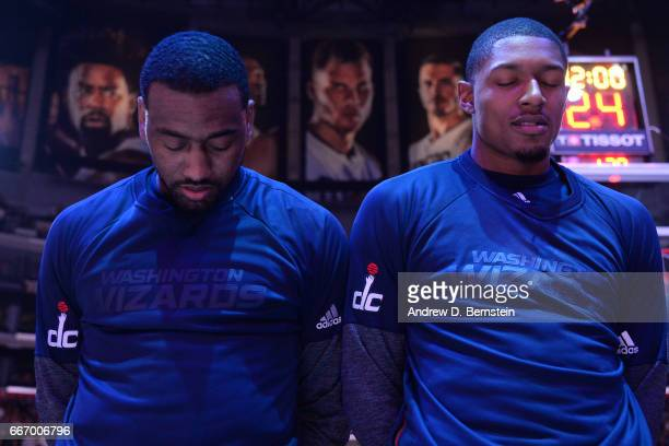 John Wall and Bradley Beal of the Washington Wizards stand for a moment of silence for the National Anthem before the game against the Los Angeles...