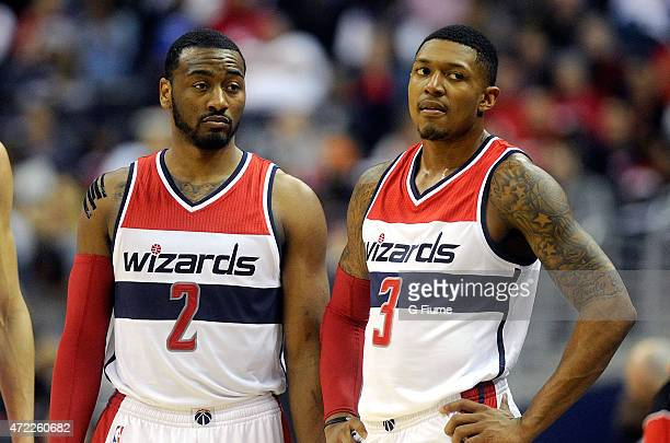 John Wall and Bradley Beal of the Washington Wizards talk during the game against the Toronto Raptors during Game Four of the Eastern Conference...
