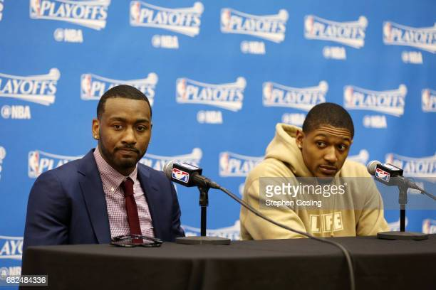 John Wall and Bradley Beal of the Washington Wizards talk with the press after the game against the Boston Celtics during Game Six of the Eastern...