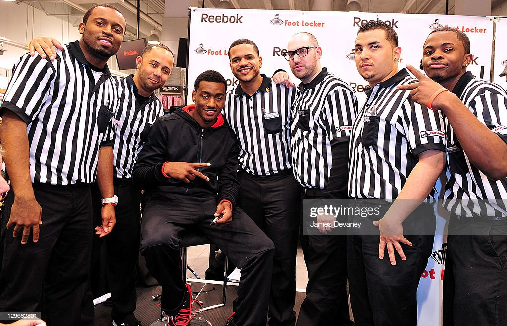 John Wall and Foot Locker employee's attend the debut of the 'Zig Encore' footwear line & the 'J Wall' apparel lines at Foot Locker - Herald Square on October 19, 2011 in New York City.