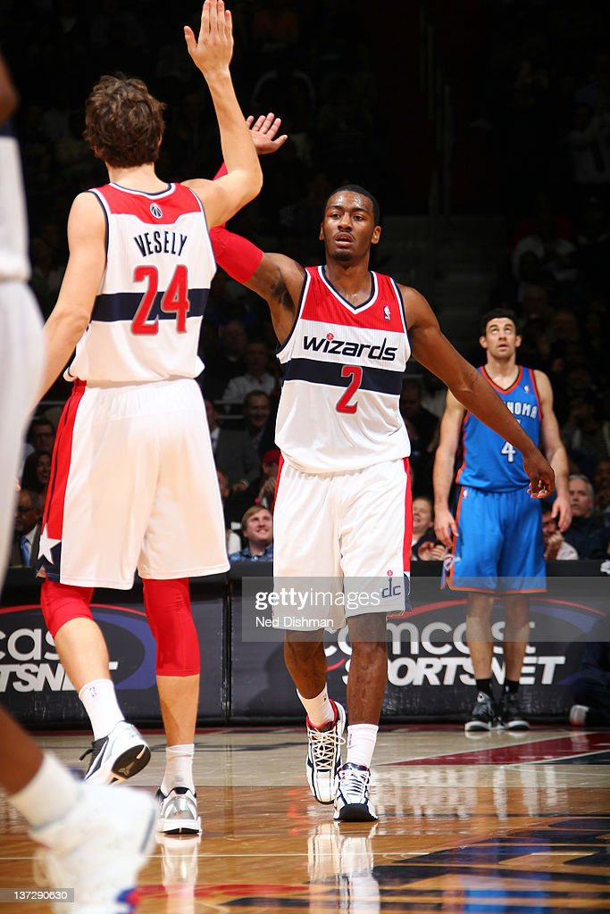 <a gi-track='captionPersonalityLinkClicked' href=/galleries/search?phrase=John+Wall&family=editorial&specificpeople=2265812 ng-click='$event.stopPropagation()'>John Wall</a> #2 and <a gi-track='captionPersonalityLinkClicked' href=/galleries/search?phrase=Jan+Vesely&family=editorial&specificpeople=5620499 ng-click='$event.stopPropagation()'>Jan Vesely</a> #24 of the Washington Wizards celebrate a basket against the Oklahoma City Thunder during the game at the Verizon Center on January 18, 2012 in Washington, DC.