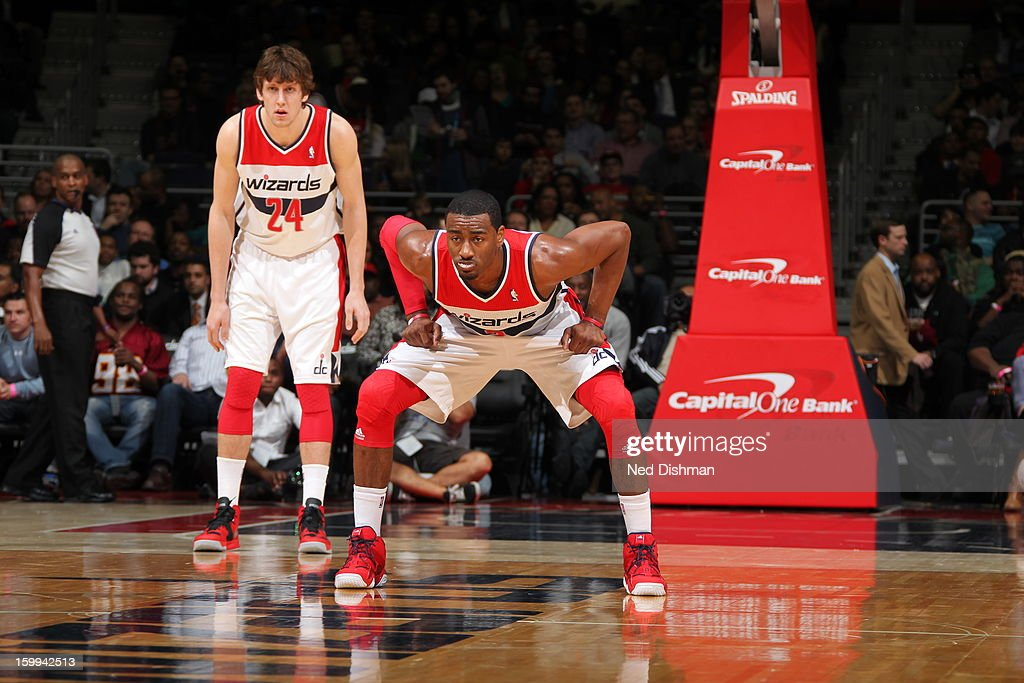 <a gi-track='captionPersonalityLinkClicked' href=/galleries/search?phrase=John+Wall&family=editorial&specificpeople=2265812 ng-click='$event.stopPropagation()'>John Wall</a> #2 and <a gi-track='captionPersonalityLinkClicked' href=/galleries/search?phrase=Jan+Vesely&family=editorial&specificpeople=5620499 ng-click='$event.stopPropagation()'>Jan Vesely</a> #24 of the Washington Wizards defend against Orlando Magic at the Verizon Center on January 14, 2013 in Washington, DC.