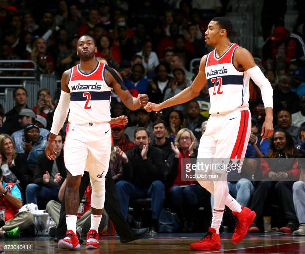 John Wall and Otto Porter Jr #22 of the Washington Wizards high five during the game against the Atlanta Hawks on November 11 2017 at Capital One...
