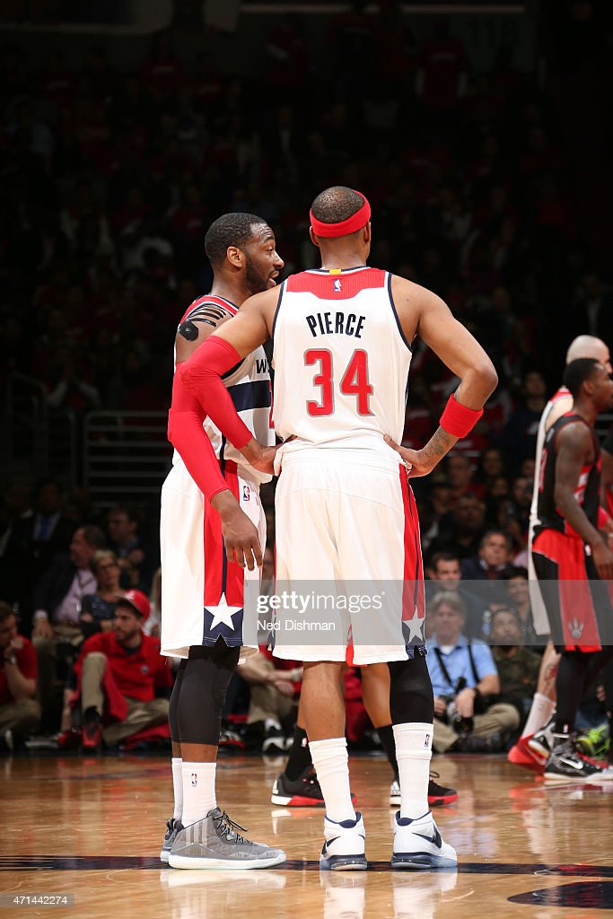 John Wall #2 and Paul Pierce #34 of the Washington Wizards talk in Game Three of the Eastern Conference Quarterfinals against the Toronto Raptors during the 2015 NBA Playoffs on April 24, 2015 at Verizon Center in Washington, DC.