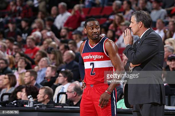 John Wall and Randy Wittman of the Washington Wizards talk during the game against the Portland Trail Blazers on March 8 2016 at the Moda Center...