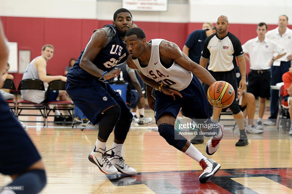 John Wall drives to the basket against Kyrie Irving of the USA Basketball Men's National Team during practice at the Mendenhall Center at the...