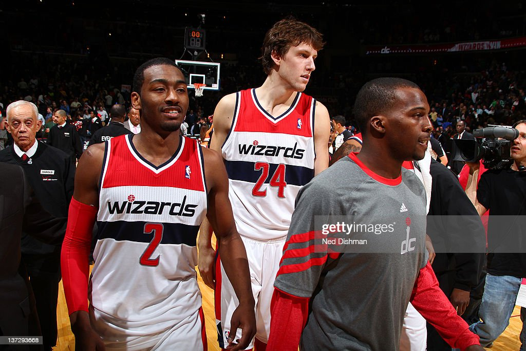 <a gi-track='captionPersonalityLinkClicked' href=/galleries/search?phrase=John+Wall&family=editorial&specificpeople=2265812 ng-click='$event.stopPropagation()'>John Wall</a> #2, <a gi-track='captionPersonalityLinkClicked' href=/galleries/search?phrase=Jan+Vesely&family=editorial&specificpeople=5620499 ng-click='$event.stopPropagation()'>Jan Vesely</a> #24 and Shelvin Mach #22 of the Washington Wizards celebrate a win against the Oklahoma City Thunder during the game at the Verizon Center on January 18, 2012 in Washington, DC.