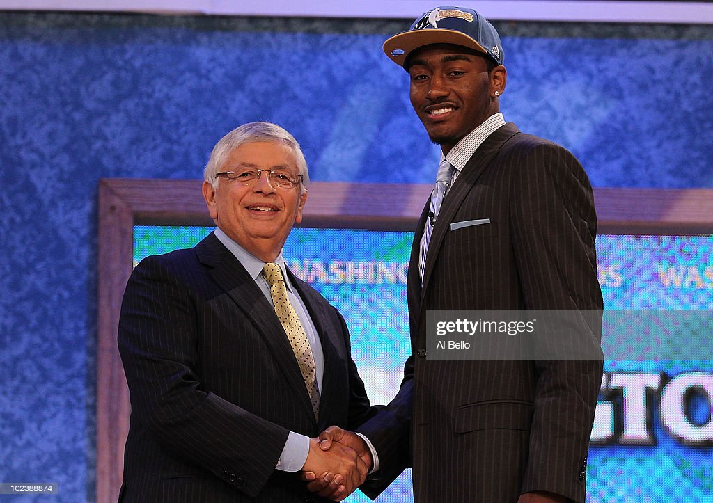 <a gi-track='captionPersonalityLinkClicked' href=/galleries/search?phrase=John+Wall&family=editorial&specificpeople=2265812 ng-click='$event.stopPropagation()'>John Wall</a> of Kentucky stands with NBA Commisioner <a gi-track='captionPersonalityLinkClicked' href=/galleries/search?phrase=David+Stern&family=editorial&specificpeople=206848 ng-click='$event.stopPropagation()'>David Stern</a> after being drafted with the first pick by the Washington Wizards at Madison Square Garden on June 24, 2010 in New York City.