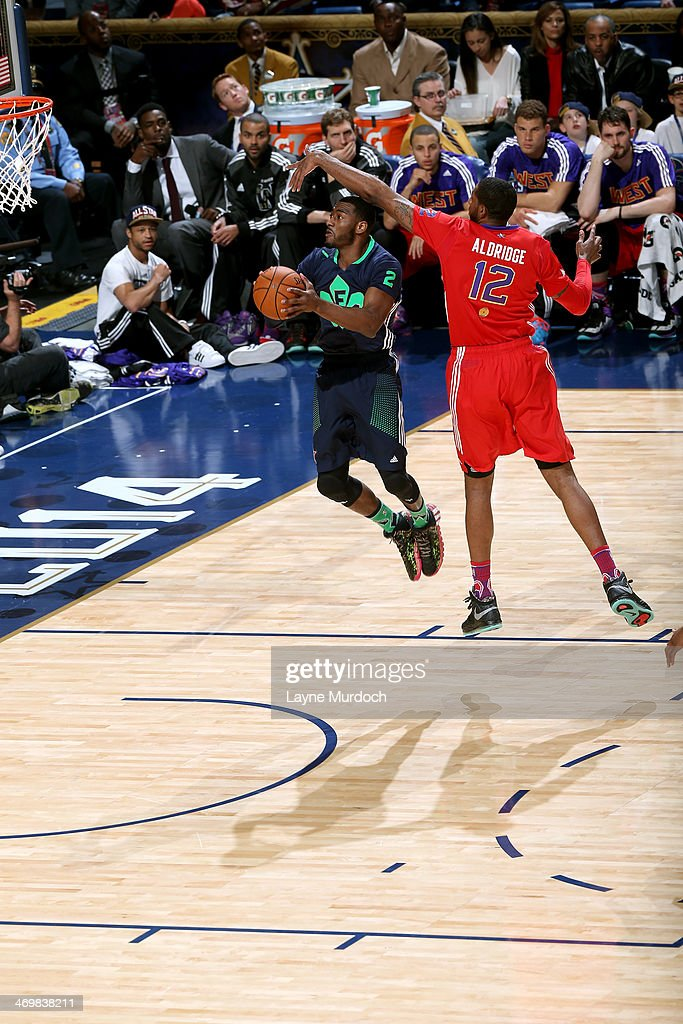 <a gi-track='captionPersonalityLinkClicked' href=/galleries/search?phrase=John+Wall&family=editorial&specificpeople=2265812 ng-click='$event.stopPropagation()'>John Wall</a> #2 of the Eastern Conference All-Stars shoots against <a gi-track='captionPersonalityLinkClicked' href=/galleries/search?phrase=LaMarcus+Aldridge&family=editorial&specificpeople=453277 ng-click='$event.stopPropagation()'>LaMarcus Aldridge</a> #12 of the Western Conference All-Stars during the 2014 NBA All-Star Game at Smoothie King Center on February 16, 2014 in New Orleans, Louisiana.