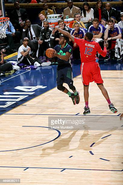 John Wall of the Eastern Conference AllStars shoots against LaMarcus Aldridge of the Western Conference AllStars during the 2014 NBA AllStar Game at...