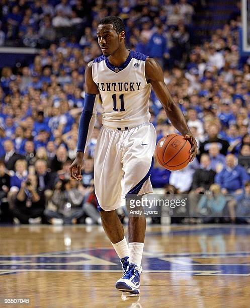 John Wall of the Kentucky Wildcats dribbles the ball during the game against the Sam Houston State Bearkats at Rupp Arena on November 19 2009 in...