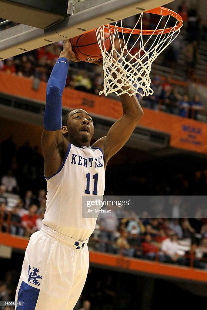 John Wall #11 of the Kentucky Wildcats dunks in the second half against the Cornell Big Red during the east regional semifinal of the 2010 NCAA men's basketball tournament at the Carrier Dome on March 25, 2010 in Syracuse, New York.