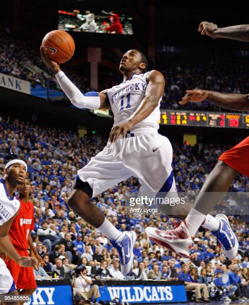 John Wall of the Kentucky Wildcats shoots the ball during the game against the Hartford Hawks at Rupp Arena on December 29 2009 in Lexington Kentucky...